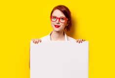 Girl in shirt and glasses with white board Stock Photography