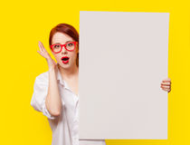Girl in shirt and glasses with white board Royalty Free Stock Photography