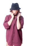 Girl in shirt and hat Stock Images
