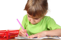 Girl in shirt painting in notebook Royalty Free Stock Photo