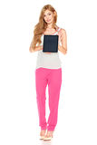 Girl in shirt and pants with tablet computer Stock Photos