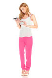 Girl in shirt and pants with tablet computer Royalty Free Stock Photo