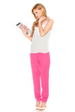 Girl in shirt and pants with tablet computer Royalty Free Stock Photos