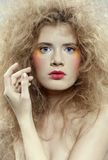 Girl with shock hair-do Stock Images