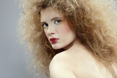 Girl with shock hair-do Stock Photos