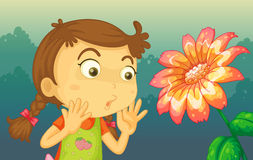 A girl shocked by a giant flower Stock Photography