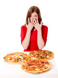 Girl shocked by the pizzas. Girl shocked by the size of pizzas royalty free stock photo