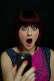 Girl Shocked at Text Message on Cell Phone Stock Photos