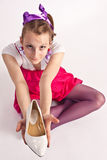 Girl with shoe Royalty Free Stock Image