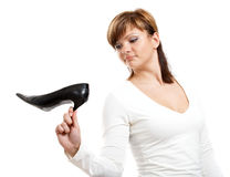 Girl with shoe Stock Images