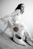 Girl and shoe. Fashion shoe and beautiful girl as background Royalty Free Stock Photo