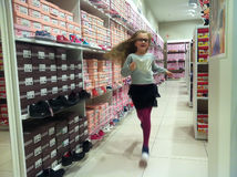 Girl in shoe shop  Royalty Free Stock Photography