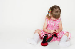 The girl and shoes Royalty Free Stock Image