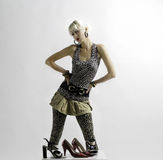 Girl and shoes. Beautiful blonde fashion girl and shoes Stock Photos