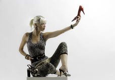Girl and shoes. Beautiful blonde fashion girl and shoes Stock Image