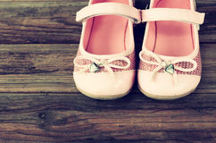 Girl shoes over old wooden deck floor. Girl shoes over wooden deck floor pic stock images