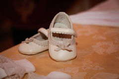 Girl shoes over tablecloth. Filtered image. Royalty Free Stock Photo
