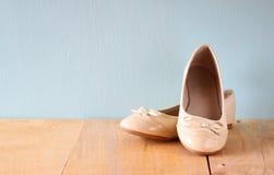Girl shoes over wooden deck floor.  stock image