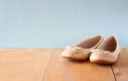 Girl shoes over wooden deck floor.  royalty free stock images