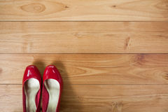 Girl shoes over wooden deck floor. A girl shoes over wooden deck floor stock photo