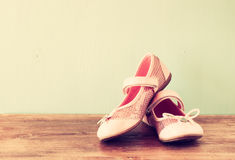 Girl shoes over wooden deck floor. Filtered image royalty free stock photos