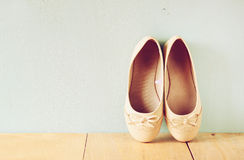 Girl shoes over wooden deck floor. filtered image Stock Photo