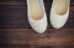 Girl shoes over wooden deck floor. filtered image. Girl shoes over wooden deck floor. filtered image stock images