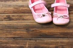 Girl shoes over wooden deck floor. Girl shoes over old wooden deck floor pic royalty free stock image