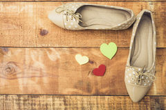 Girl shoes over wooden deck floor. Vintage effect filter style pictures stock images