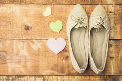 Girl shoes over wooden deck floor. Vintage effect filter style pictures royalty free stock photos