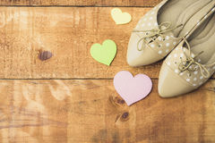 Girl shoes over wooden deck floor. Vintage effect filter style pictures stock photography