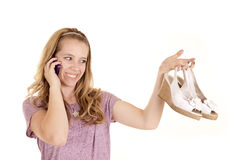 Girl with shoes on phone Royalty Free Stock Photos