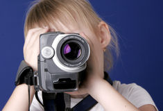 Girl shoot home video. Little girl shoot the video with home video camcorder Royalty Free Stock Images