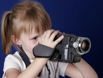 Girl shoot home video. Little girl shoot the video with home video camcorder Royalty Free Stock Image