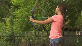 Girl shoot of toy bow. Girl shoot of a toy bow stock footage