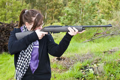 Girl shooting airgun Stock Photography
