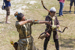 Girl shooting arrows Royalty Free Stock Images