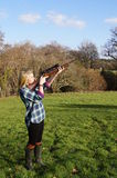 Girl Shooting Game. Girl with rifle shooting game in rural English countryside Stock Photos