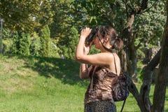 Girl shooting photo. A girl shootin photos in a park of kharkiv ukraine Stock Photos