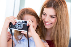 Girl shooting with a vintage camera Stock Photo