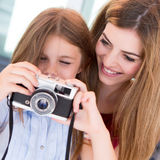 Girl shooting with a vintage camera Royalty Free Stock Photography