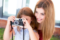 Girl shooting with a vintage camera Royalty Free Stock Photos