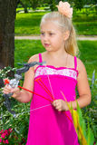 Girl shoots a bow. Girl in the park archery Royalty Free Stock Images