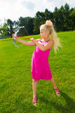 Girl shoots a bow. Girl in the park archery Royalty Free Stock Image