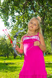 Girl shoots a bow. Girl in the park archery Stock Photo