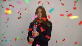 Girl shoots confetti cracker and smiles. Slow motion video stock video footage