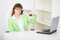 Girl shoots himself in head in office Stock Image