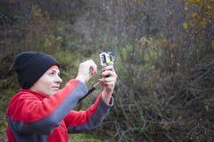 Girl shoots video. Stock Image