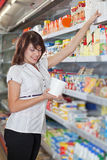 The girl  in shop chooses mayonnaise Royalty Free Stock Photo