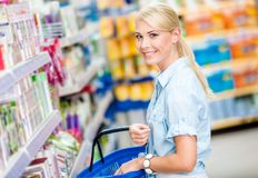 Girl at the shop choosing cosmetics Stock Image